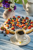 Coffee and fruit tarts served in the garden royalty free stock photos