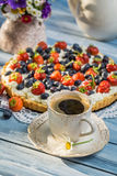 Coffee and fruit tarts served in the garden Royalty Free Stock Image