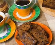 Coffee and Fruitcake. Hot black coffee and dark fruit cake Royalty Free Stock Images