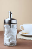 Coffee with funny sugar dispenser stock photography