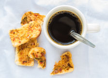 Coffee with garlic bread on table cloth Royalty Free Stock Photos