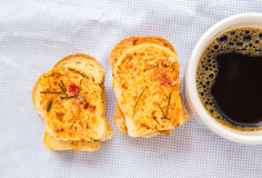 Coffee with garlic bread on table cloth Stock Photos
