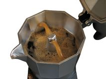 Spouting coffee in a geyser type coffee maker. Gushing coffee in a geyser type coffee maker isolated on a white background. The boiling water is forced through stock photos