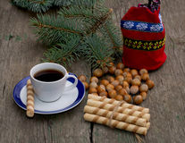 Coffee, gift bag, forest nutlets, linking of cookies and fir-tre Stock Photo