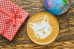 Coffee, gift box and globe. Royalty Free Stock Photography