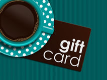 Coffee with gift card lying on tablecloth. Cup of coffee with gift card lying on tablecloth Stock Photo