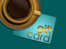 Coffee with gift card lying on tablecloth Royalty Free Stock Photography