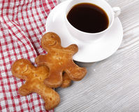 Coffee and ginger gingerbreads. Morning black coffee in a cup and ginger gingerbreads Stock Photos