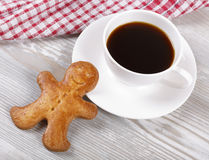Coffee and ginger gingerbreads. Morning black coffee in a cup and ginger gingerbreads Royalty Free Stock Images