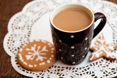 Coffee and gingerbread cookie Stock Image