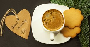 Coffee and gingerbread cookies on a dark table, good morning concept, close-up stock photography