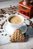 Coffee, gingerbread and old retro mill grinder Stock Images