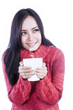Coffee girl in jumper isolated in white Royalty Free Stock Photo