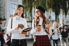 Coffee. Girls. Happy Together. Student. Courtyard stock image