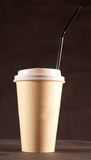 Coffee glass. Paper coffee glass on brown background Stock Photo