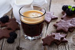 Coffee in a glass with chocolate cookies Royalty Free Stock Images