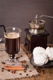 Coffee in glass cup and cinnamon with zephyr Royalty Free Stock Image