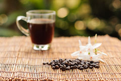 Coffee in glass trasparent cup and bean Royalty Free Stock Image