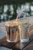 Coffee and a glass of water Royalty Free Stock Photography