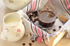 Coffee in a glass on a wooden tray Royalty Free Stock Photography