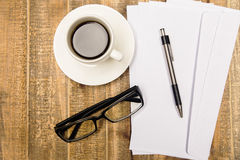 Coffee glasses and paper royalty free stock photos