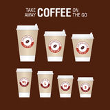 Coffee on the go cups. Different sizes of take away paper coffee Royalty Free Stock Photos