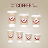 Coffee on the go cups. Different sizes of take away paper coffee Royalty Free Stock Photo