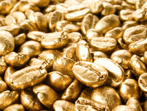 Coffee gold closeup background. Royalty Free Stock Photo