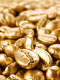 Coffee gold closeup background. Royalty Free Stock Images