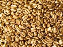 Coffee gold closeup background. Stock Photo