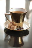 Coffee in gold cup Stock Photo