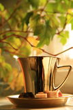 Coffee in gold cup Royalty Free Stock Image
