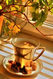 Coffee in gold cup Stock Images