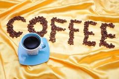 Coffee on golden fabric Stock Image