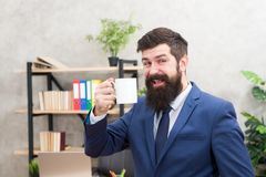 Coffee is always good idea. Man bearded businessman hold cup stand office. Start day with coffee. Successful people stock images