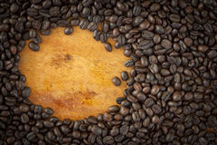 Coffee grain and cup on wood Royalty Free Stock Photography