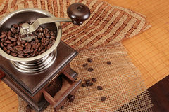 Coffee grain grinder. Old coffe grinder and coffee beans Royalty Free Stock Photos