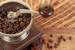 Coffee grain grinder. Old coffe grinder and coffee beans Royalty Free Stock Photo
