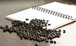 Coffee grain on note book paper Royalty Free Stock Photography