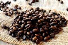 Coffee grain seeds on table of wood Stock Images