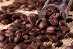 Coffee grains. Many coffee grains, macro,background. glass pipe Royalty Free Stock Photography