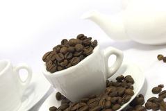 Coffee grains. In a white cup, ware for coffee Stock Photo