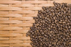 Coffee in grains. Coffee in grains on a background of a tree Royalty Free Stock Photo