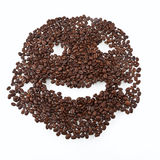 Coffee grains arranged in smiley. Isolated on white background Stock Image