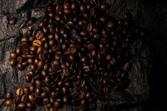 Coffee grains on a black background stock images