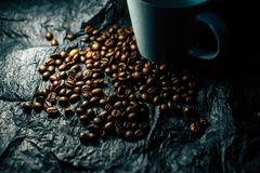 Coffee grains on a black background royalty free stock photos