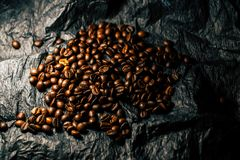 Coffee grains on a black background stock photo