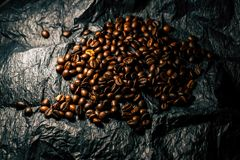 Coffee grains on a black background royalty free stock photo