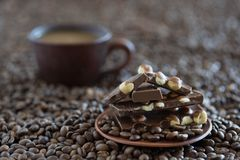 Coffee grains and black chocolate close up royalty free stock photos