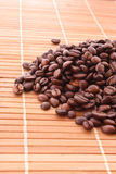 Coffee grains on brown background Royalty Free Stock Photos